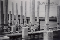 """Pilons spliced ready to be driven deeper into the sea bed when building the port.  photo from """"The Peter Burch Collection""""."""