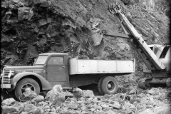 Loading  truck with dirt and rocks.