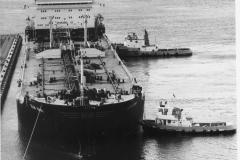 A ship tying  up to No. 5 berth.